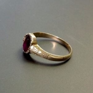 1796-BEAUTIFUL EARLY VICTORIAN CHASED GARNET SET RING
