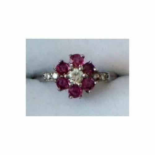 18CT WHITE GOLD RUBY AND DIAMOND CLUSTER RING -