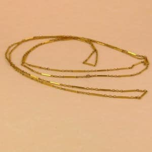VICTORIAN 9CT ROLLED GOLD LONG GUARD CHAIN - CIRCA 1880 -