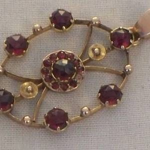 1829-ANTIQUE 9CT ROSE GOLD GARNET PENDANT