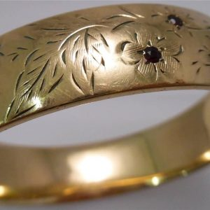 1939-VINTAGE 9CT ROLLED GOLD HINGED BANGLE - HALF ENGRAVED - SET WITH GARNETS